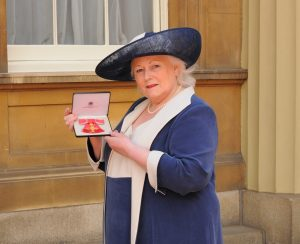 The Queen honours Brightwells chair with OBE